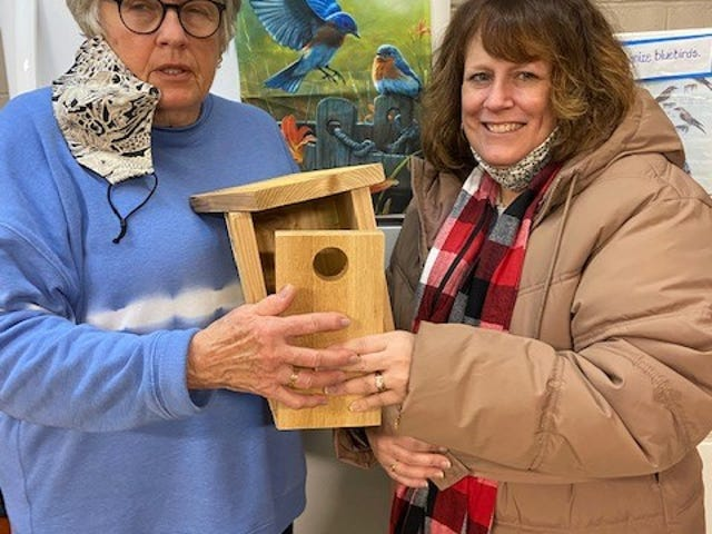 In January Deb Pigman (left), a member of Earth, Wind and Flowers Garden Club, and her daughter Erin Lacey spent some workshop time assembling nest boxes for bluebirds. Erin already has them in her yard near Worthington.