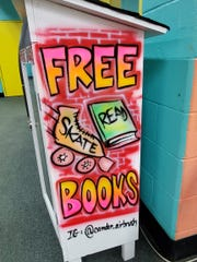 A Book Ark outside Millennium Skate World in Camden shows the airbrush, graffiti-influenced style of Anthony Dillard, who uses the name Tone Lōk for his art.