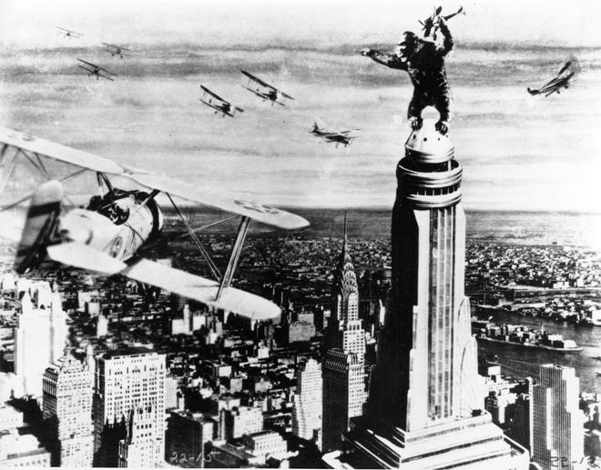 """In the 1933 film """"King Kong,"""" the colossal creature climbs atop New York's Empire State Building, snatching a fighter plane as he's attacked."""