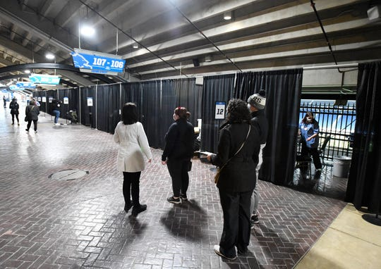 Curtained off stations along the concourse of Ford Field for COVID-19 vaccinations for educators and education staff hosted by Meijer. Meijer hosts a COVID-19 vaccine clinic at Ford Field exclusively for educators and education staff in Detroit, Michigan on March 1, 2021.