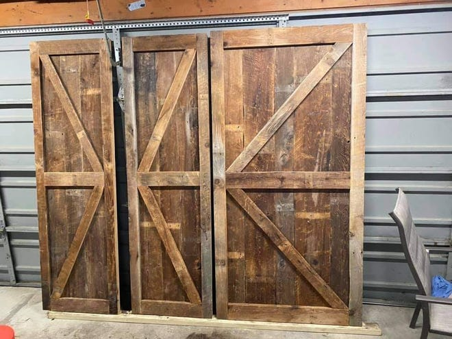 Reclaimed Michigan in Waterford Township crafted these doors from the brown roof boards that were once on a Cass City barn in Michigan's thumb.