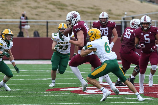 Memorial graduate Branson Combs (83) caught three passes for 42 yards as Southern Illinois snapped North Dakota State's 39-game winning streak last Saturday.