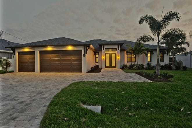 This house by SPO Construction in Cape Coral was scheduled to be in the Lee County Building Industry Association's Parade of Homes, but it sold so fast that they had to pull the model from the event.