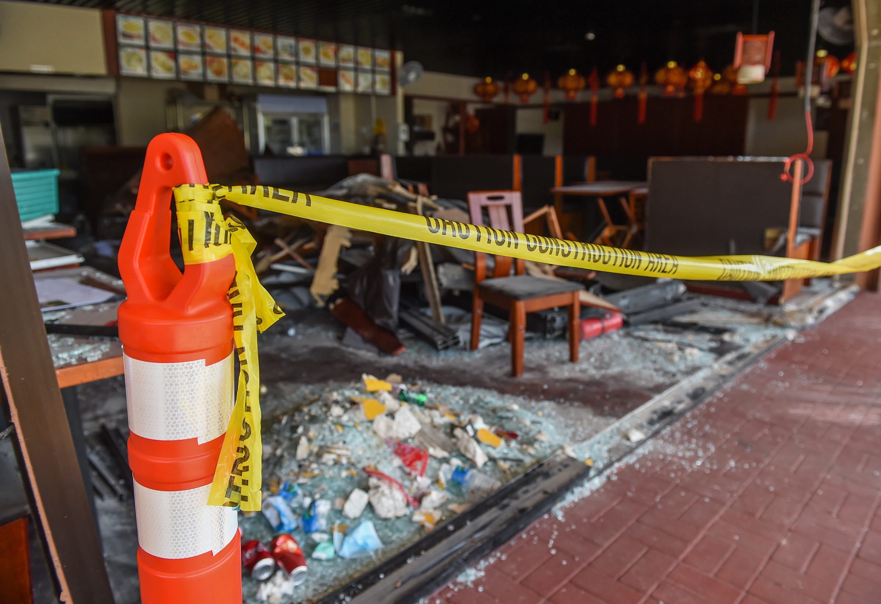 Caution tape and cones block off a crash scene at Jerry Kitchen in Tamuning in this March 1 file photo. The Guam Police Department has provided no updates to an ongoing investigation involving a red Jeep that crashed into the restaurant Feb. 25.