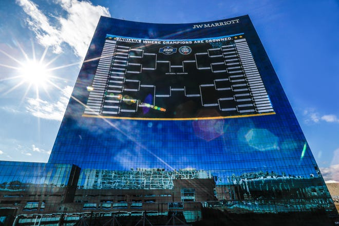 A giant NCAA tournament bracket adorns the J.W. Marriott on Monday, March 1, 2021, in downtown Indianapolis. The city is hosting the upcoming tournament.