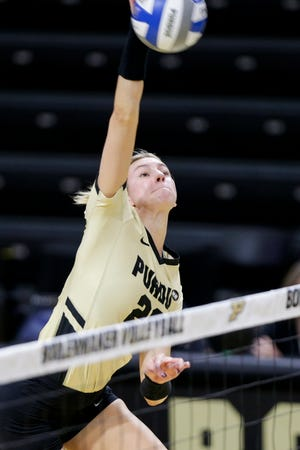 Purdue outside hitter Grace Cleveland (20) hits the ball during the first set of an NCAA women's volleyball game, Sunday, Feb. 28, 2021 at Holloway Gymnasium in West Lafayette.