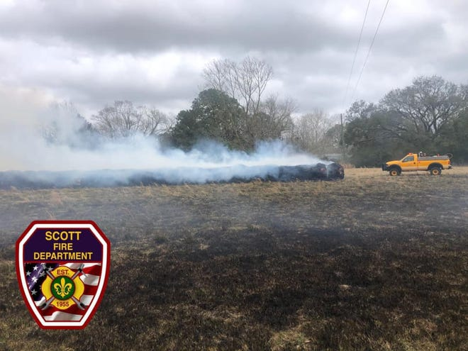 The Scott Fire Department and other agencies in Lafayette Parish extinguish a fire after bales of hay were ignited by arson on Feb. 28, 2021.