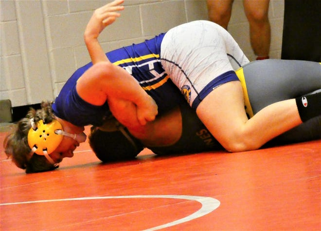 Bloom-Carroll sophomore Collin Willet pins Buckeye Valley sophomore Sam Jones to earn third place at 182 pounds during the Division II sectional tournament.