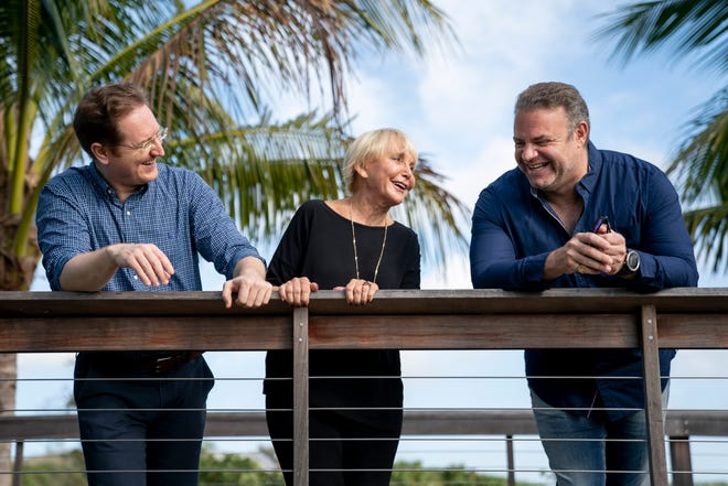 From left to right, Ramón Tebar, Opera Naples artistic and music director, Sondra Quinn, Opera Naples executive director, and Joseph Calleja, operatic tenor, laugh while they pose for a portrait at Baker Park in Naples on Monday, March 1, 2021.