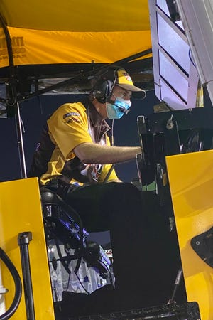 Central York High graduate Ben Beshore works during a race earlier this season. Beshore is the crew chief for NASCAR driver Kyle Busch's car this season.