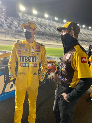 Ben Beshore, right, speaks with NASCAR driver Kyle Busch. Beshore is the crew chief for Busch's car this season.