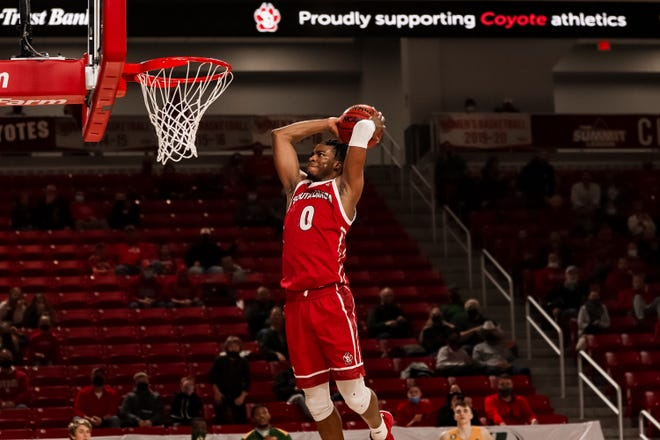 South Dakota's Stanley Umude goes up for a dunk against North Dakota State on Feb. 28 in Vermillion.