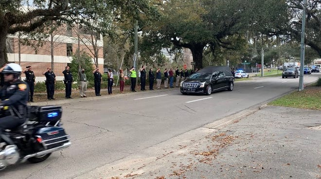Tallahassee police officers line the street Monday morning as aprocession passes in front of TPDin honor of Decatur County Lt. Justin Bedwell, who was shot in the line of duty in Brinson, Georgia, and died at TMH on March 1, 2021.
