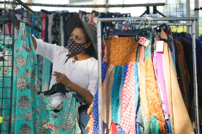 A vendor sets up their booth at the start of the Stuart Green Market at Flagler Park on Sunday, Feb. 28, 2021, in downtown Stuart. The market is held every Sunday from 9 a.m. until 2 p.m., rain or shine.
