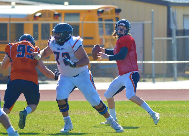 COS quarterback Nathan Lamb, a former Tulare Union standout, passes during the Giants' intrasquad scrimmage on Feb. 27, 2021 at CVC.