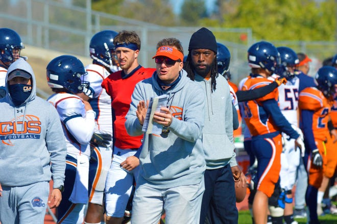 COS football coach Travis Burkett motivates players during the Giants' intrasquad scrimmage on Feb. 27, 2021 at CVC.