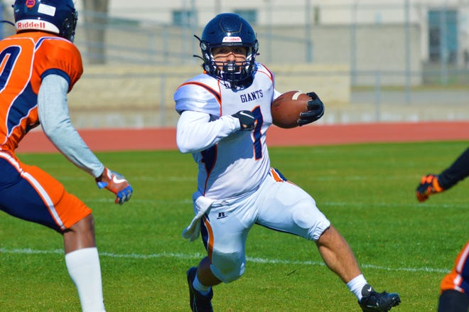 COS running back Jaedyn Pineda, a former Mt. Whitney standout, runs during the Giants' intrasquad scrimmage on Feb. 27, 2021 at CVC.