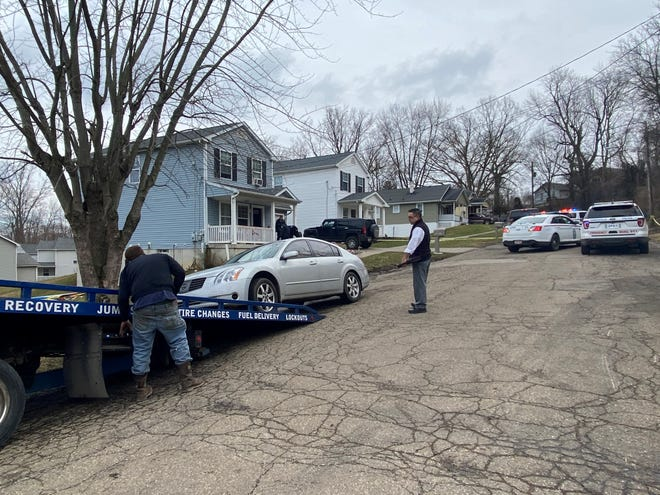 The Zanesville Police Department removed a car from the scene of a shooting on Bates Street Monday morning.