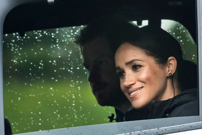 Prince Harry and Duchess Meghan of Sussex arrive for the unveiling of a plaque dedicating native bush to the Queen's Commonwealth Canopy project in Auckland, New Zealand, on Oct. 30, 2018.