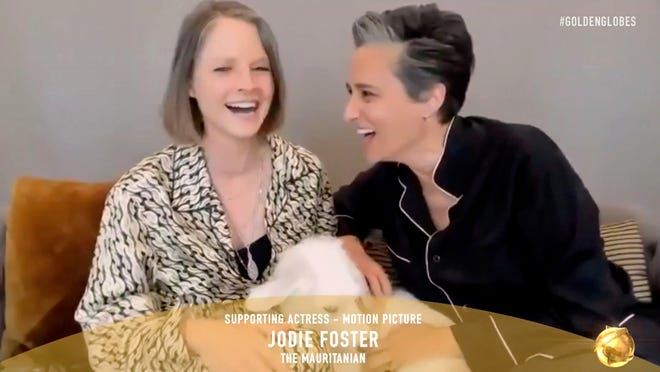 Jodie Foster, with wife Alexandra Hedison, speaking during Foster's Golden Globe best actress win.
