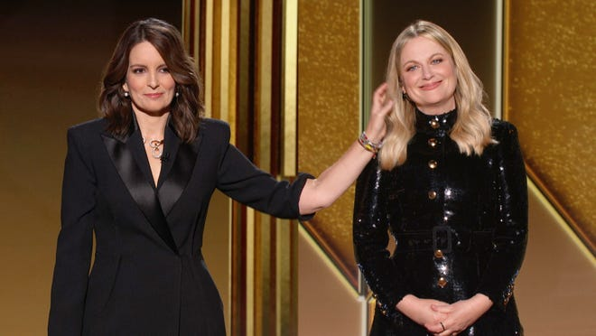 Golden Globe hosts Tina Fey and Amy Poehler during the 78th Annual Golden Globe Awards at The Beverly Hilton Hotel.