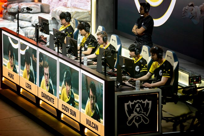 Participants compete on their computers during the group stage of the 'League of Legends' world championships in Berlin, Germany, on Oct. 13, 2019.