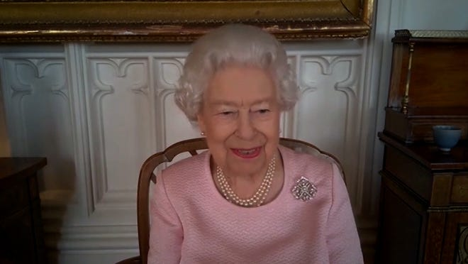 Queen Elizabeth II talks to officials in Adelaide, South Australia via video conference call, on Feb. 24, 2021, about vaccine distribution and a new statue recently unveiled on Government House grounds.