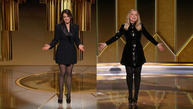 Golden Globe hosts Tina Fey and Amy Poehler during the 78th Annual Golden Globe Awards at The Beverly Hilton Hotel. Tina Fey and Amy Poehler kickstarted awards season Sunday as hosts of the 78th annual Golden Globe Awards, where TV shows and films were honored in a hybrid virtual/in-person show.