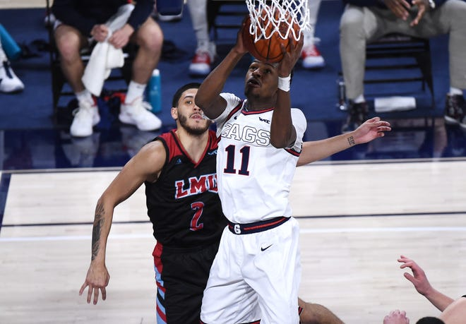 Gonzaga guard Joel Ayayi goes up for a basket against Loyola Marymount guard Joe Quintana during their game at McCarthey Athletic Center.