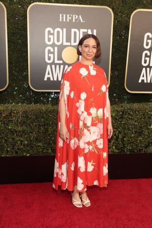 Comedian Maya Rudolph brings a pop of color to the awards show in a flowing floral flock.