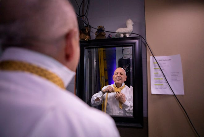 Jim Spencer, chief weathercaster for KXAN, gets dressed before a nightly broadcast on Feb. 9. Spencer has semi-retired after 30 years with the news station but will work part time on KXAN's First Warning Weather team.