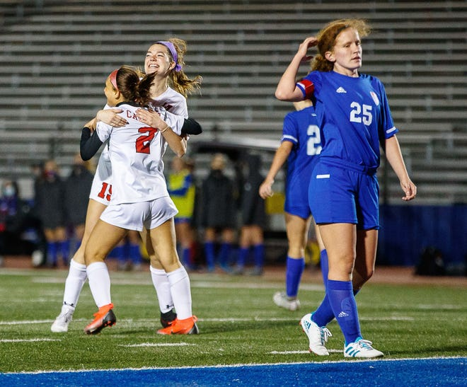 Lake Travis Cavaliers' Jessica Wade celebrates with teammate Giana Bourland (No. 2) after her goal during the first half at the District 26-6A girls soccer game on Monday at Westlake High School. Lake Travis won 2-0 to tighten its grip on first place in District 26-6A.