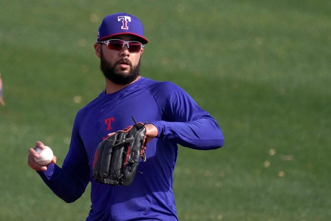 Texas Rangers' Isiah Kiner-Falefa throws during a spring training practice Friday in Surprise, Ariz. Kiner-Falefa, a Gold Glove-winning third baseman last season, moved over to shortstop after veteran Elvis Andrus signed with the Oakland Athletics.