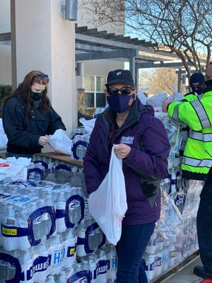 Mayor Connie Schroeder and city workers and volunteers distributed water to residents during the winter storms.