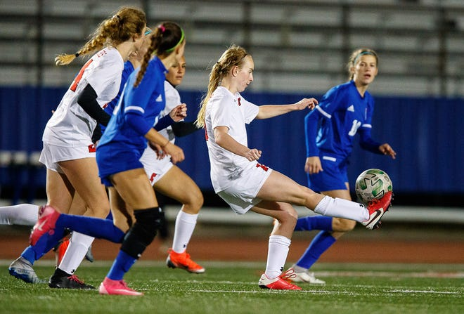 Lake Travis Cavaliers' Peyton Ferrell controls the ball against the Westlake Chaparrals during the second half at the District 26-6A girls soccer game on Monday at Westlake High School.