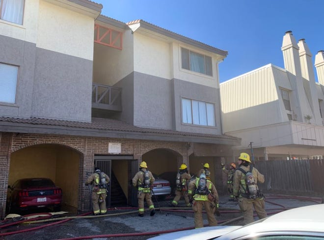 Austin firefighters on Tuesday try to extinguish a fire reported at an apartment complex in West Campus, near the University of Texas at Austin.