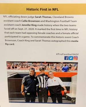 Callie Brownson, Jennifer King and Sarah Thomas made history last season, when two women coaches and a female official participated in the same NFL game. This sign is on display at the Pro Football Hall of Fame.