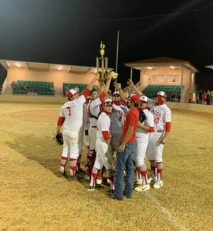 The Benavides baseball team hoists its trophy after winning the Riviera Tournament this past weekend.
