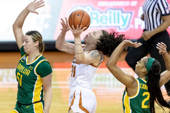 Texas guard Audrey Warren goes to the basket against Baylor's Caitlin Bickle, left, and DiJonai Carrington during Monday night's 64-57 Lady Bears victory at the Erwin Center. Baylor secured the outright Big 12 regular-season title with the win.