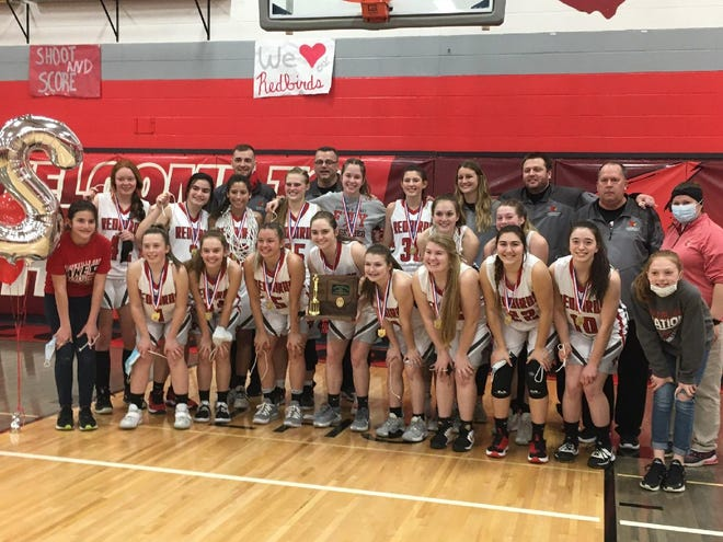 Members of the Loudonville girls basketball team pose for a picture on Saturday after winning the program's first district title since 1992 and only the second in school history.