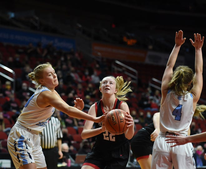 Roland-Story's Madeline Morton goes between Unity Christian's Jenna Bouma (left) and Tyra Hulstein on a drive to the hoop during the second half of the Norse's 70-42 loss to the Knights in the Class 3A quarterfinals of the girls' state basketball tournament Tuesday at Wells Fargo Arena in Des Moines. Roland-Story finished a memorable season at 17-5.
