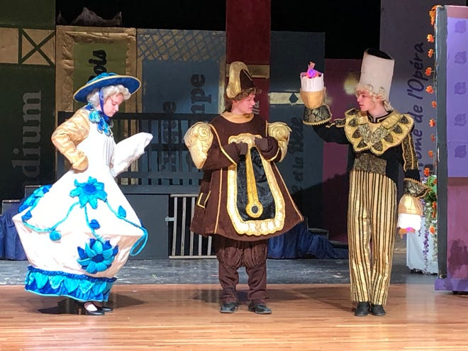 A scene from the play: Mrs. Potts, played by Akela Salter; Cogsworth: Jason Prazak; and Ben Lumley as Lumiere.