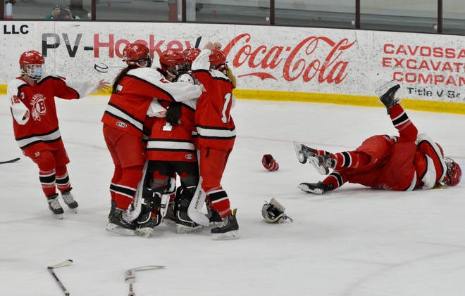 Barnstable players celebrate their win over Falmouth Sunday at Falmouth Ice Arena. To see more photos, go to www.capecodtimes.com/news/photo-galleries.