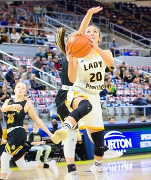 Fairview senior Rylee Jinks (20) flies in for the layup during the Lady Panthers' victory over Florien on Monday in the Class B semifinals. Jinks had 19 points and 11 rebounds in the contest.