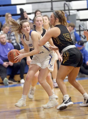 Boonville senior Brooke Eichelberger looks to pass the ball to a teammate in the third quarter Monday night against Fulton in the semifinal round of the Class 4 District 8 Tournament in Boonville.