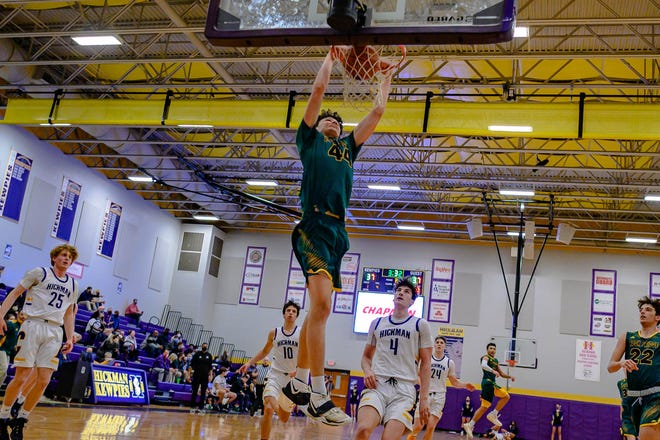 Rock Bridge's Kanyon Hummel (44) dunks the ball against Hickman during a Class 6 District 8 semifinal Monday night at Hickman High School. Hummel led all scorers with 20 points.