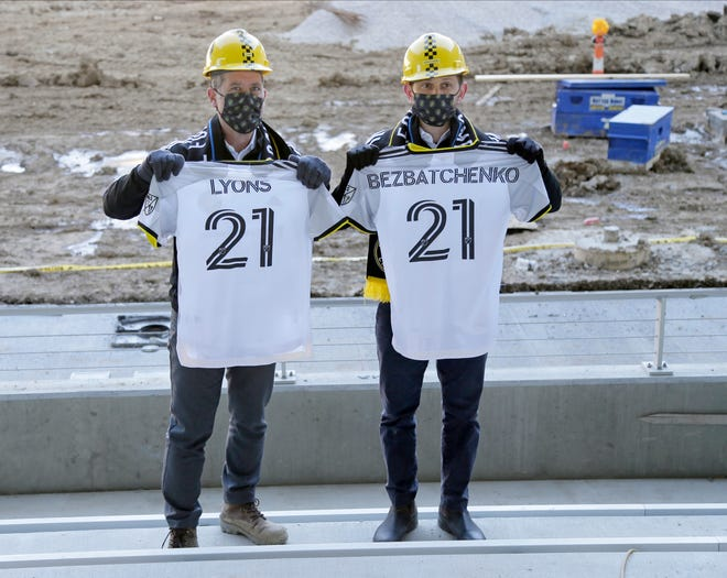 Steve Lyons, Crew SC Executive Vice President Chief Business Officer, and Tim Bezbatchenko, President & General Manager, display the team's new primary kit for the 2021 season at the new Crew Stadium on Tuesday.