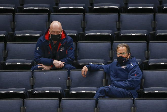 Blue Jackets general manager Jarmo Kekalainen, left, and coach John Tortorella watched the team during a preseason practice.
