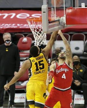After scoring 30 points in the loss to Michigan, Duane Washington Jr., here trying to score against Iowa on Sunday, has scored 24 in the past two games while going 2 for 12 from three and 10 for 26 overall.