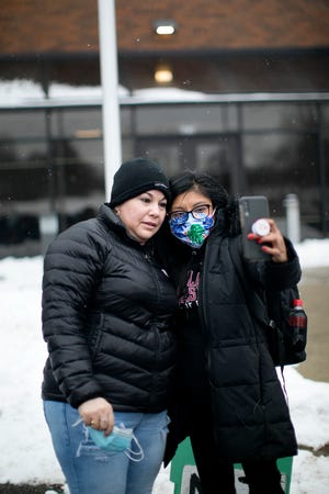 Lizbeth Mateo, right, the lawyer for Edith Espinal, left, takes a selfie at the U.S. Immigration and Customs Enforcement office in Westerville on Feb. 18 after getting an order of supervision for Espinal that allowed her to leave the church where she was staying in sanctuary.